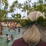 woman watches the Puuhonua o Honaunau hukilau