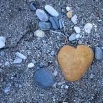 Heart shaped rock on beach
