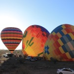Balloons inflating in the desert