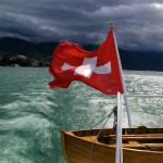 lake boat with Swiss flag