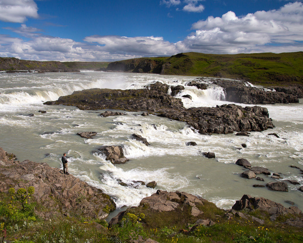 iceland fishing in waterfall